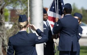 Soldiers saluting flag in honor